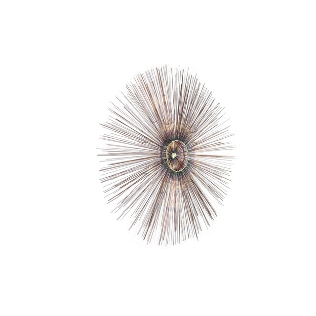 Large-scale copper sunburst wall sculpture, circa 1950s. Nicely executed all around with two layers of hundreds of copper...