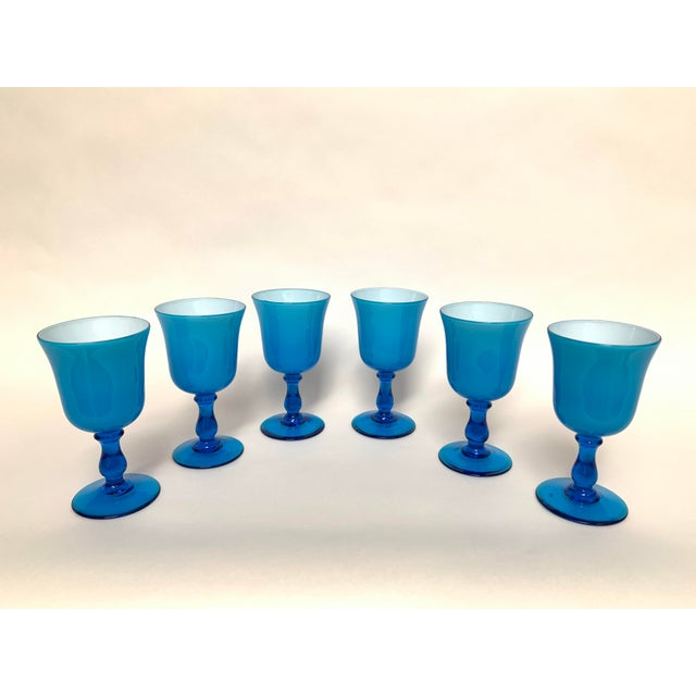 Set of 6 blue cased glass chalice form glasses in the style of Italian glass designer and manufacturer Carlo Moretti, ca....