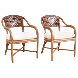 Pair of McGuire Bamboo and Woven Leather Armchairs For Sale