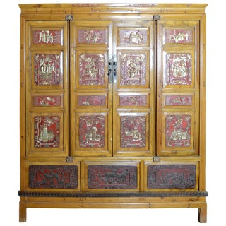 19th Century Qing Dynasty Chinese Hand-Carved Armoire With Gilt Painted Panels For Sale