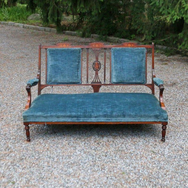 A wonderful Edwardian Settee with inlaid mahogany frame and blue velvet upholstery. This piece needs full restoration as...