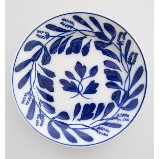 A lovely pair of 19th-Century Dutch Delft plates, hand painted with a foliate pattern in cobalt blue and white, by Petrus...