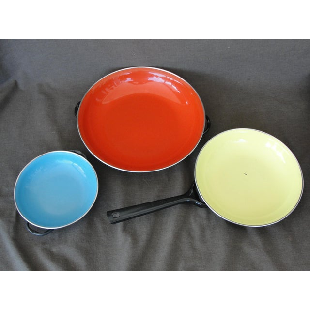4 Piece Enameled Steel Saute Pans Made in Yugoslavia This is a 4 piece set of mid century modern enameled steel saute pans...