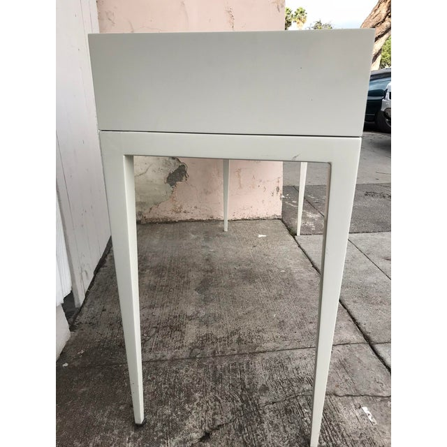 Contemporary Lacquer Wood Console in an off-white finish and metal drawer handles. There is a little wear and tear on it...