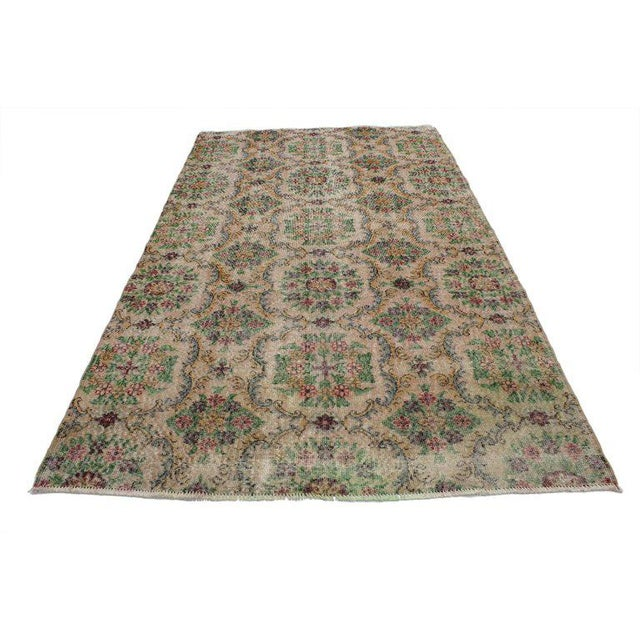 Zeki Muren distressed vintage Turkish Sivas rug with Swedish farmhouse style. Shabby chic is the best way to describe this...