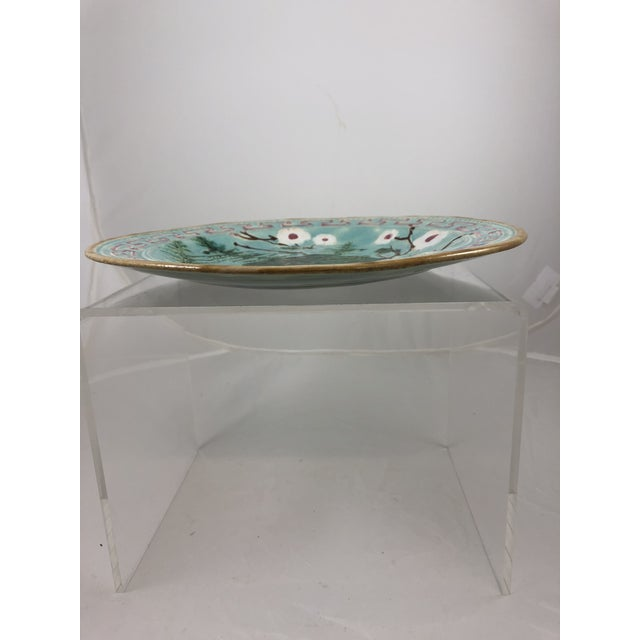 French majolica plate with a pink Greek key born, light turquoise beaded rim and and saffron edge. Delicate fern with...