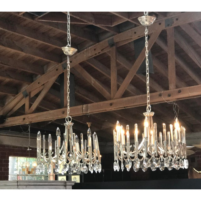 Pair of Gaetano Sciolari chandeliers in silver plate and crystal. Very elegant. Sold as a pair, but willing to sell...