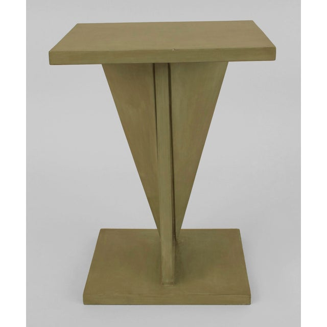 French Art Deco ebonized and light green lacquered end table with a geometric design pedestal base having a small shelf...