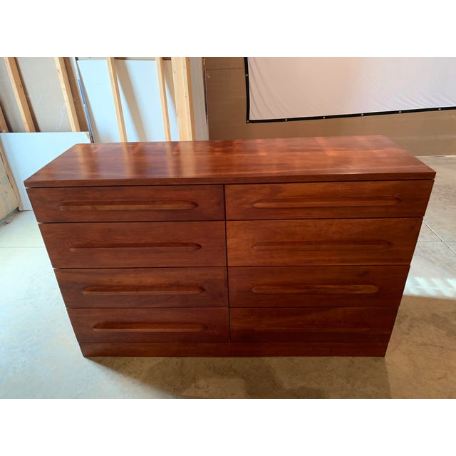 Large 20th century cherry eight drawer dresser, graduated drawers with elongated pulls and a plinth base. Excellent...