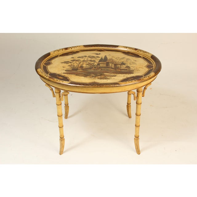 English regency style cream colored chinoiserie decorated paper mache tray, late 19th century, resting on a late 20th...