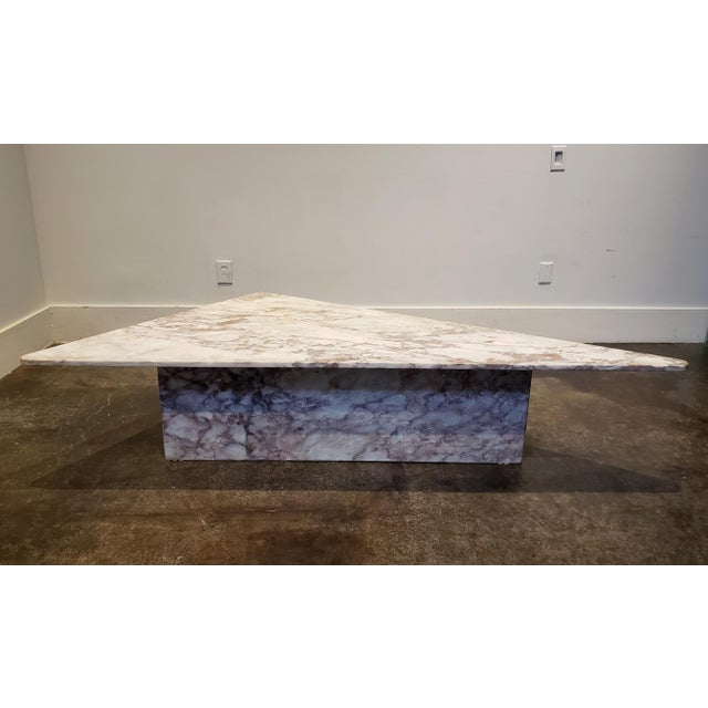1970s Italian coffee table, beautiful white marble with pinkish gray veins. Unique triangular shape with rounded edges....