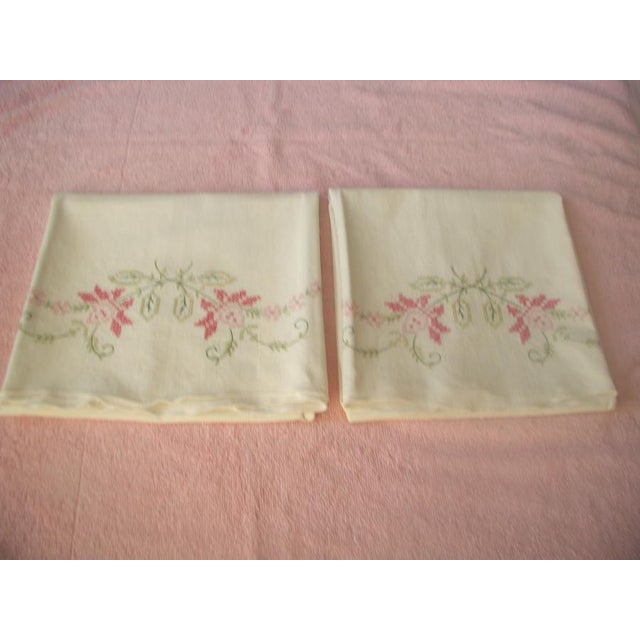 Pair of white cotton pillow cases from the 1950's. Strong and durable cotton. Beautiful hand embroidery in 2 shades of...