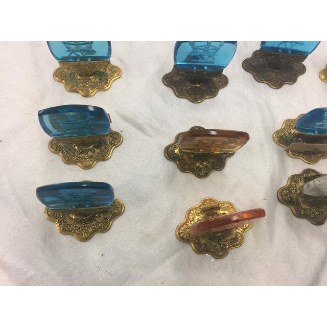 Set of 16 place card holders from the 30's, Cut glass with brass. Overall very good condition, 4 have tiny tiny feabits on...