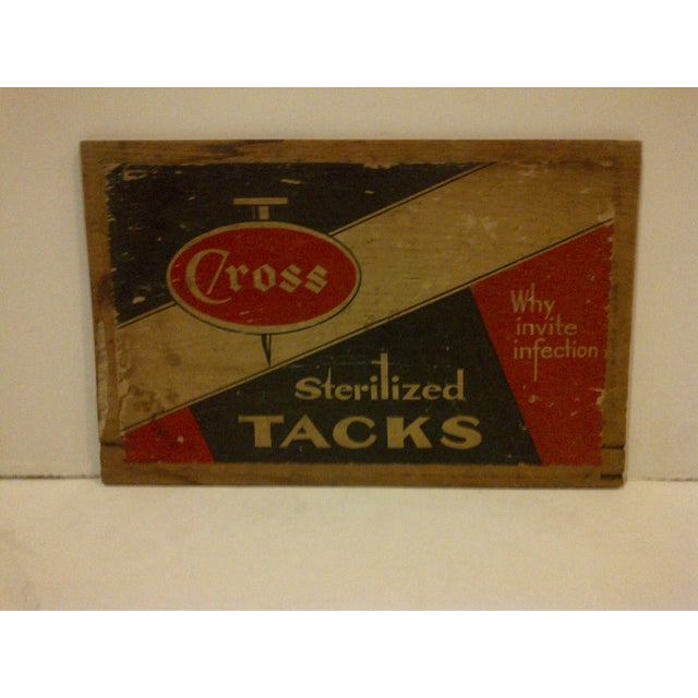 """This is a vintage wooden end of a crate reading """"Cross Sterilized Tacks"""", circa 1930. The item is in vintage condition and..."""