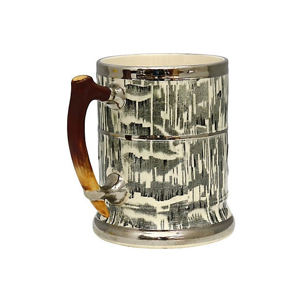 1930s Arthur Woods Silver Shield tankard. Faux-bois pattern (false wood) faux-antler handle. Shields and accents are all...