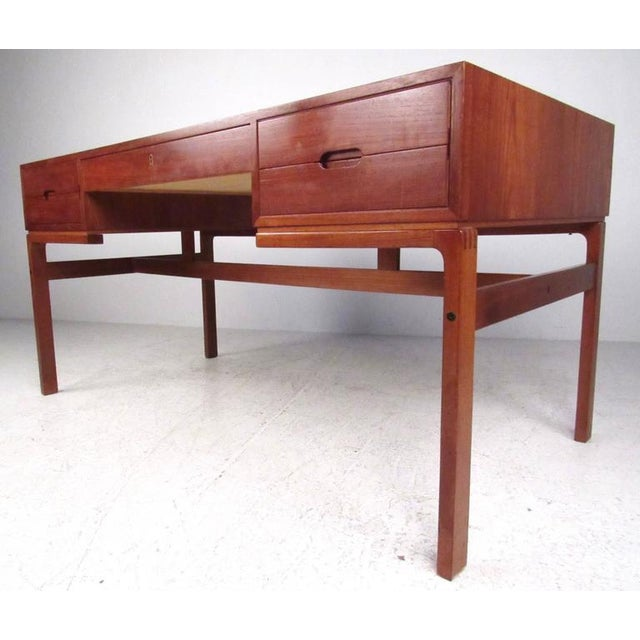 This stylish vintage Scandinavian Modern partner's desk features double-sided design with spacious drawer and shelf space...