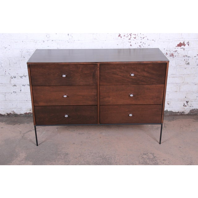 An exceptional mid-century modern six-drawer dresser or credenza from the Planner Group line designed by Paul McCobb for...