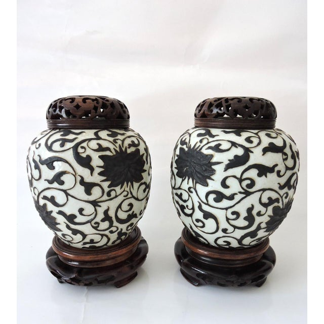 Pair of unusual matt expresso brown and white ginger jars that hard to find nowadays. Ornate, over layed raised swirls of...
