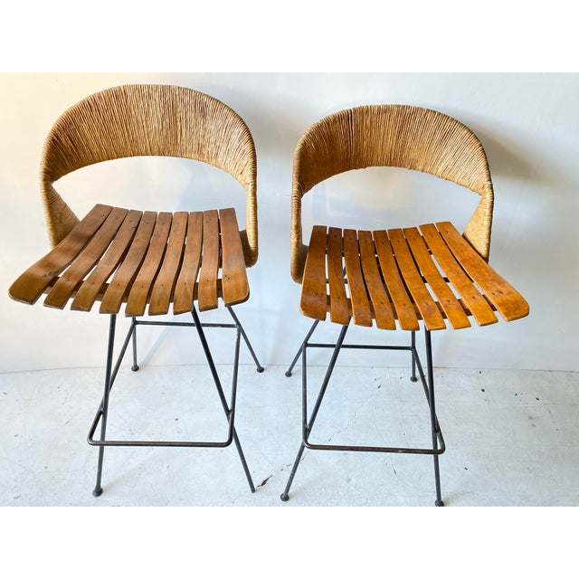 This is for a pair of wonderful Arthur Umanoff Iron barstools. They have iron frames with wood slat seats and retain...
