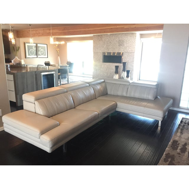 This sectional is a custom made product, Kelvin Giormani makes it available in high grain Italian leather and a variety of...