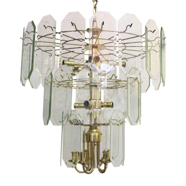 Thirty eight lightly etched glass panels decorate this three tier ten candelabra light brass chandelier. Circa 1970s-1980s.