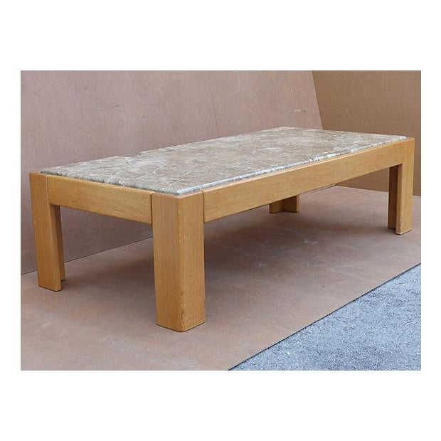 Rectangular coffee table attributed to Jim Eldon who designed it for Knoll. Beech wood block base with fitted marble top....