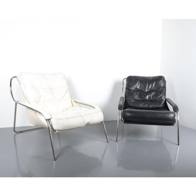 Elegant Maggiolina chair by Zanotta designed by Marco Zanuso, originally designed in 1947. Later production. Cowhide sling...