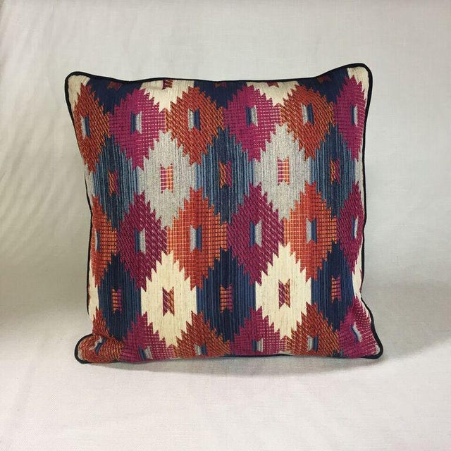 By Kim Salmela, a 20x20 pillow in designer fabrics. Tan velvet reverse, navy welt, hidden zipper closure and extra full...