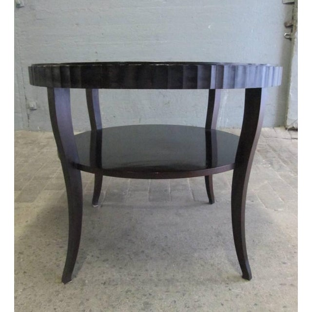 Barbara Barry centre table for Baker Furniture Co. Table has fluted sides, slender curved legs, with a single pull-out...