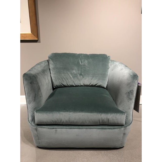 The Lucca Swivel Chair is a first quality market sample that features a green fabric. It has a springdown medium seat...