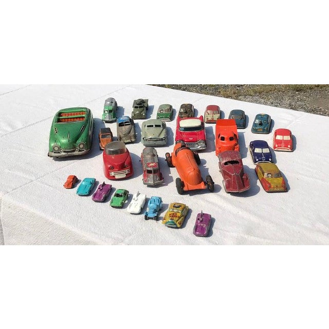 Collection of vintage toy cars. 28 total. It includes a large green tin litograph Friction Marx V89 toy convertible Car....