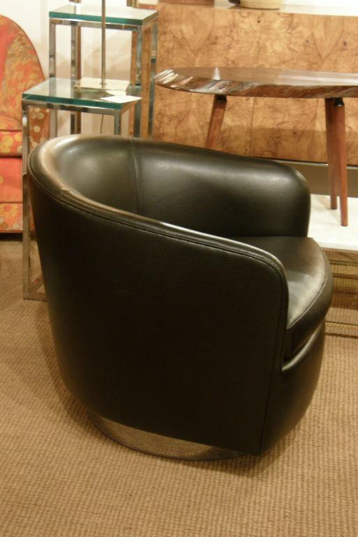 A Pair Of Chic Barrel Back Swivel And Tilt Lounge Chairs Upholstered In  Black Leather Raised