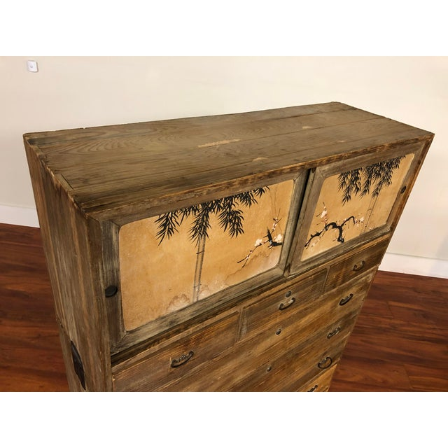 Three piece stacking tansu chest. It has metal pulls and metal handles that pop up on the sides of the two lower pieces....