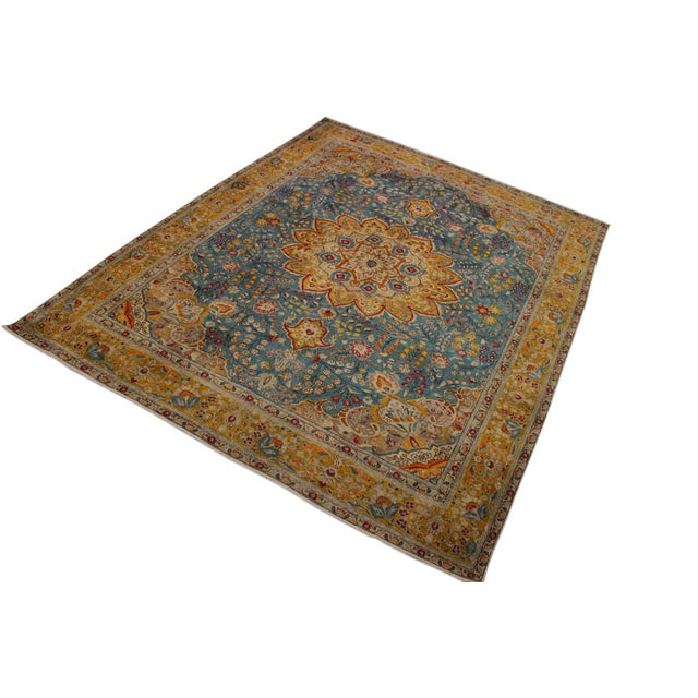 A mesmerizing addition to any décor, this brand-new hand knotted vintage distressed wool rug featuring vibrant colors and...