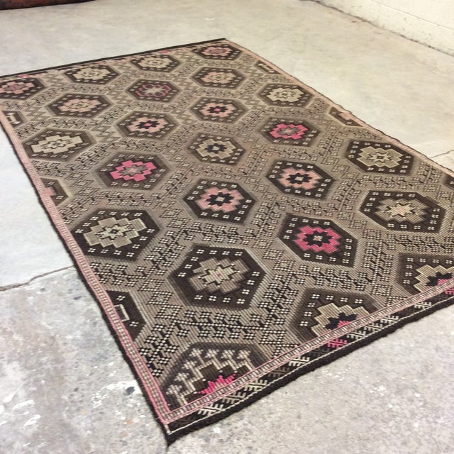 50 year old Turkish Kilim in great condition. Beautiful pinks, browns and greys in a diamond pattern. Nice weight to the...
