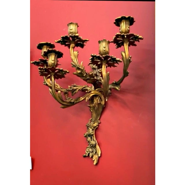 A pair of Louis XV style Rococo style five branch wall lights, an elaborate highly detailed bronze wall sconces, with...