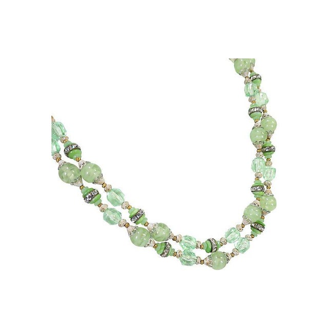 Offered here is a double-strand draping art glass necklace with white japanned gold metal findings from the 1950s. The two...