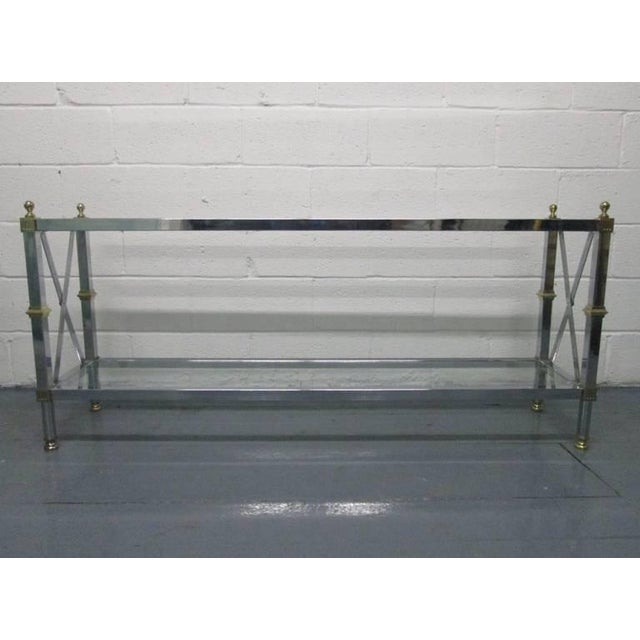 French console table. Console table has X-stretcher to the sides, with brass and chrome frame. Glass on top and bottom tiers.