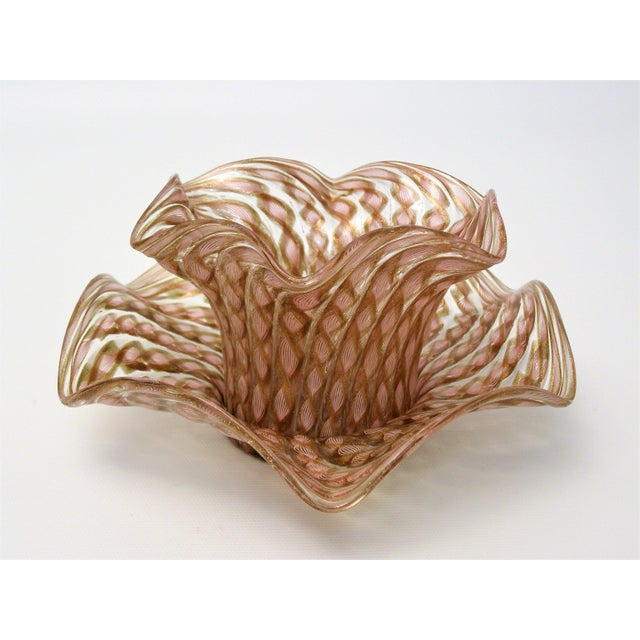 Offering a TWO piece Murano glass finger bowl and plate manufactured by Salviati, Murano Italy, circa 1950s. The design of...