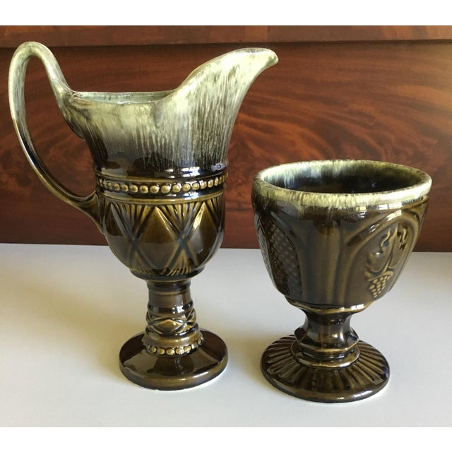 Two vintage Hull USA art pottery pieces done in beautiful drip glazes in shades of brown, green, mint green and cream. The...