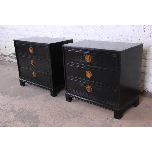 Offering a gorgeous pair of newly ebonized Hollywood Regency Chinoiserie large bedside tables or bachelor chests by Davis...