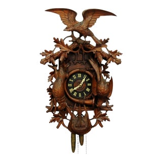 Black Forest Carved Wood Cuckoo Clock With Large Eagle On Top For Sale