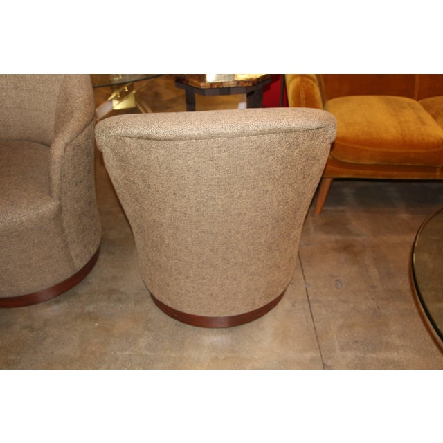 A nice pair of J. Robert Scott swivel chairs in original fabric. They are on castors as well. They feature wood bases....