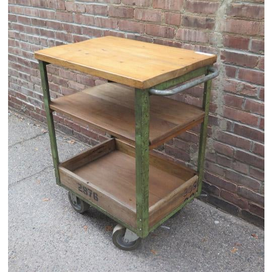 Vintage English (c. 1940) industrial trolley cart in original paint and finish with original casters.