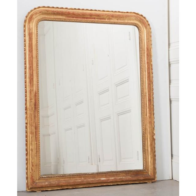 This fantastic gold gilt Louis Philippe mirror was made in France, circa 1880. The classic design of the Louis Philippe...
