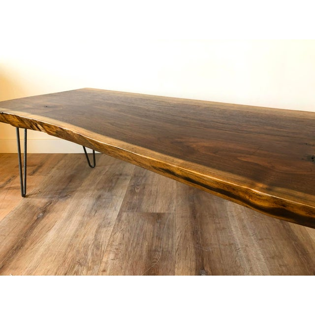 Finished semi-gloss raw edge coffee table with steel hair pin legs. Could function as a bench or coffee table.