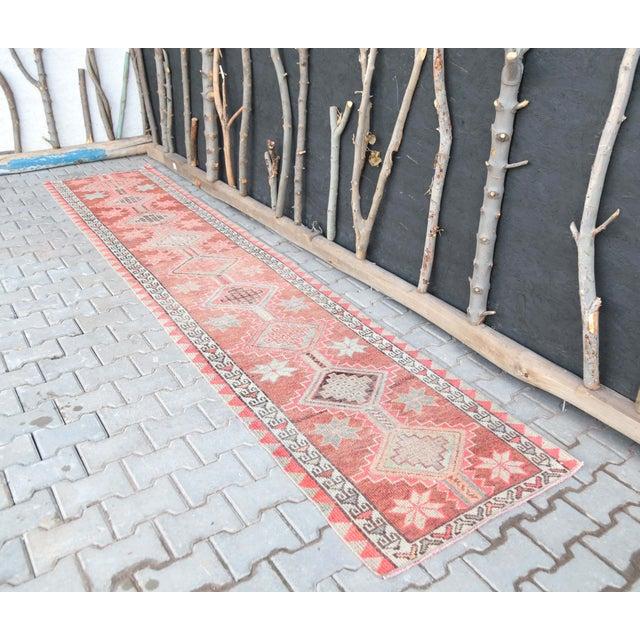 Vintage Turkish Hand-Knotted Hallway Runner Rug is a semi-antique vintage rug. '50s Eastern region of Turkey's unique rug...