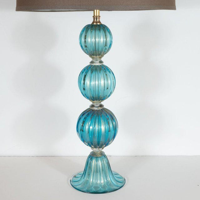 This sophisticated pair of modernist table lamps were hand blown in Murano, Italy, the island off the coast of Venice...