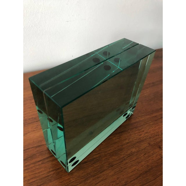 An unusual Fontana Arte minimalist picture frame. Heavy bevelled green glass with opening slot for a pic in between, circa...