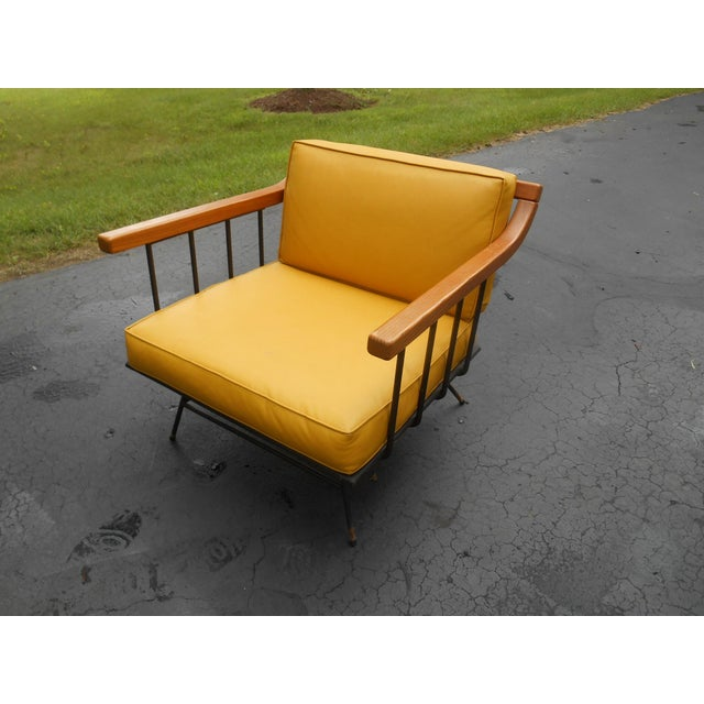This is a fabulous authentic 1960s mid-century modern maple + iron lounge chair. The piece was made in the manner of Paul...